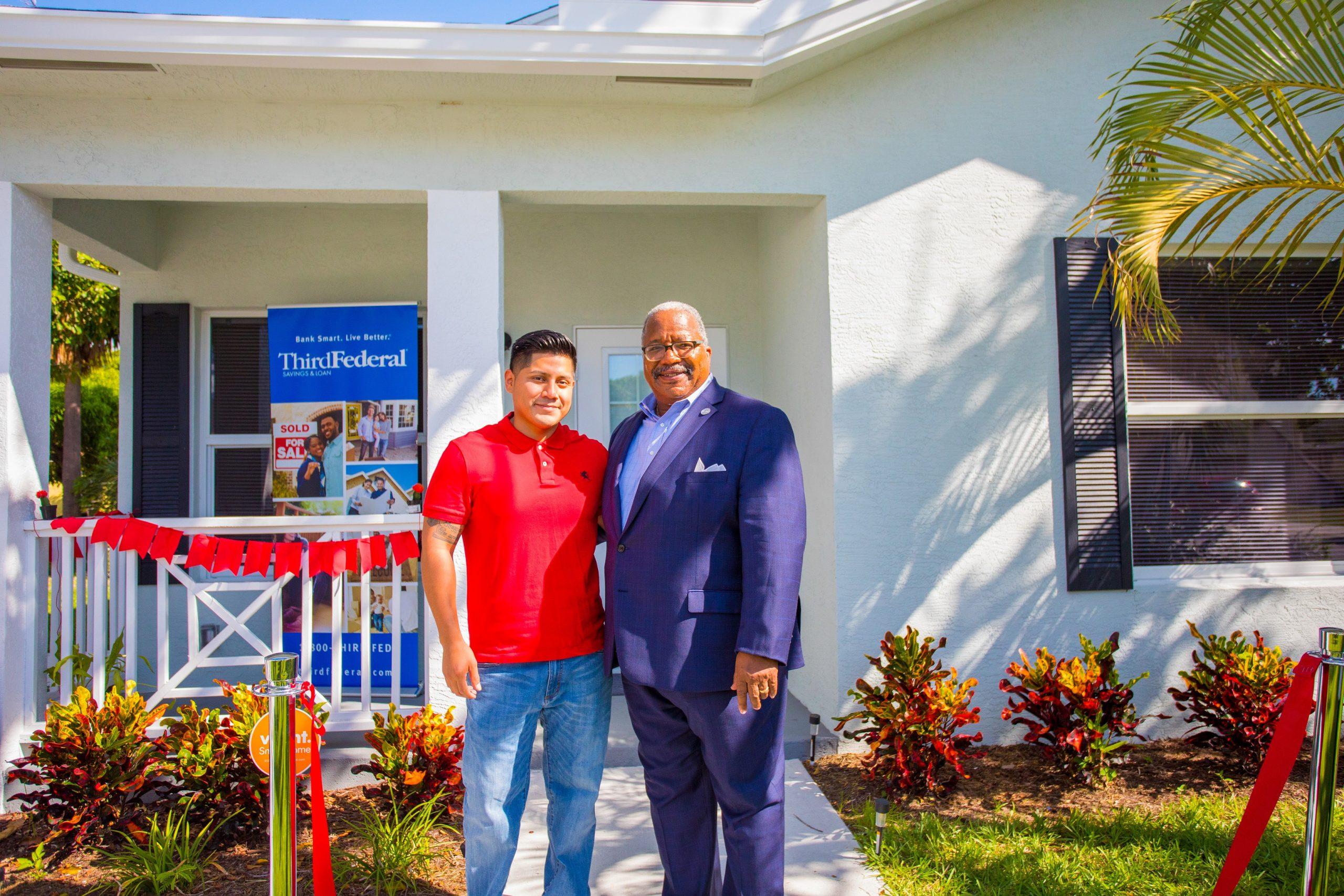 Pleasant City Mayor Keith James and new homeowner Ricky Gutierrez Lopez
